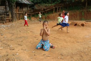 Thai_boy_hands_village