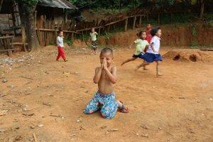 Thai_boy_hands_village